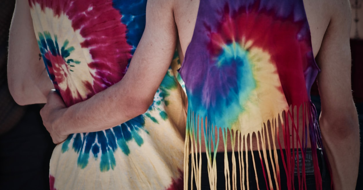 LGBT couple wearing tie-dye